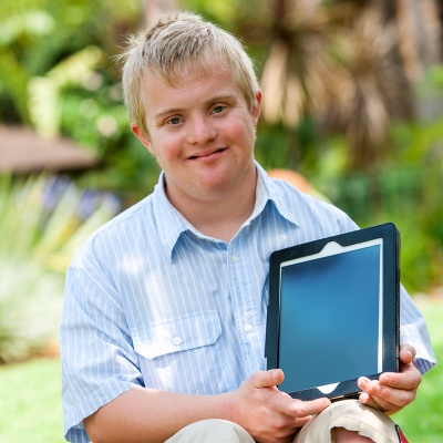 handicapped-boy-holding-tablet.jpg